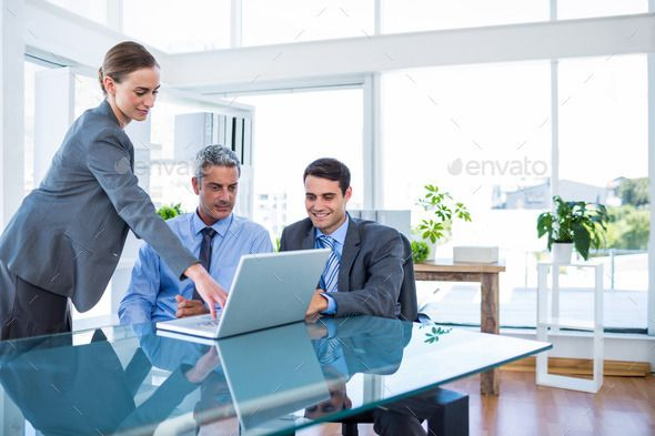 Business People Working On Laptop Computer In Office By