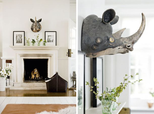 mantel design and styling.  Fab animal head centered with black and white photos and greenery