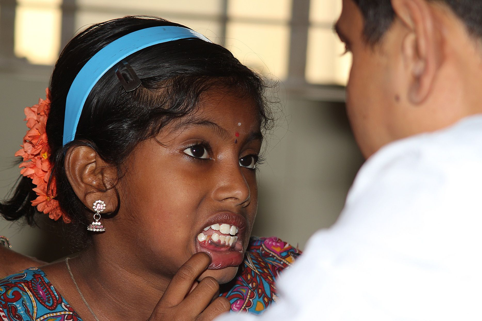 Dental screening during public health programs in india by