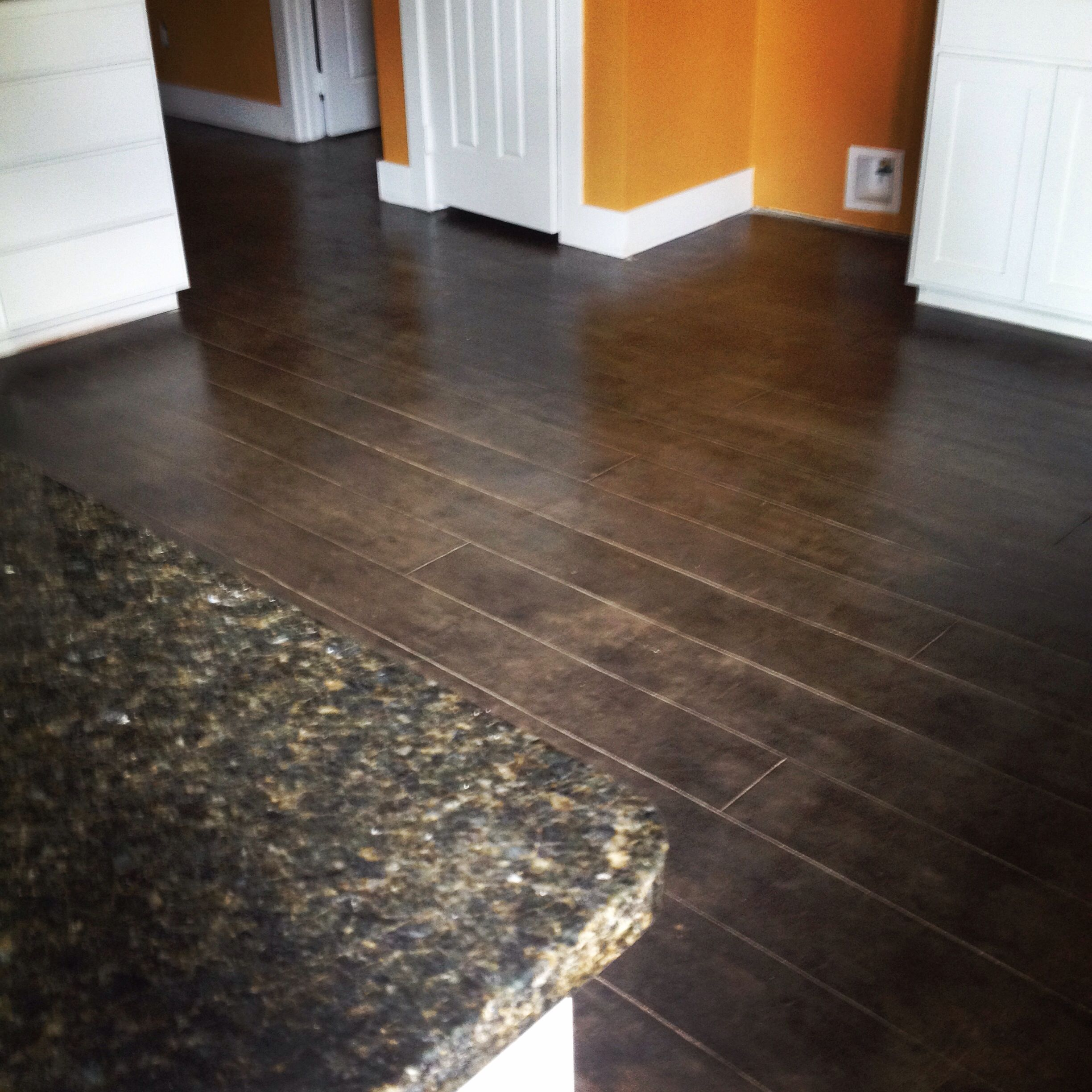 Scored & stained concrete We used black stain & a flat sealer