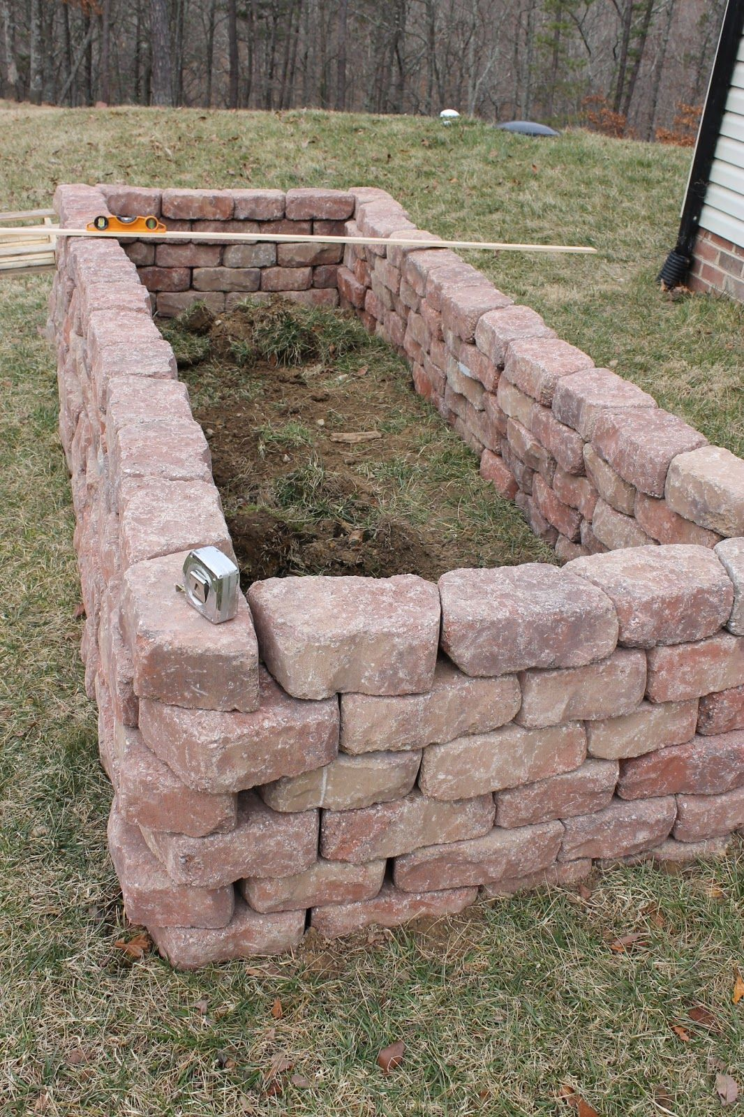 brick raised vegetable beds once all of the stones were