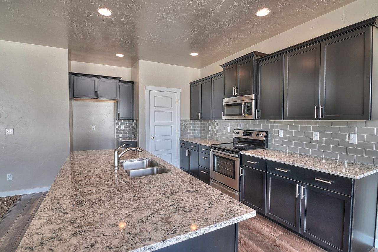 - Espresso Cabinets, Grey Subway Tile Back Splash, And Granite