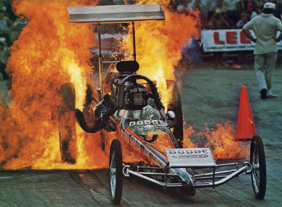 Big daddy don garlits doing a ferocious fire burnout in for Garage prudhomme 16