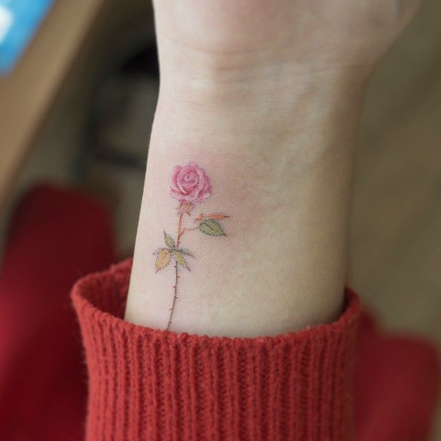 Lovely and so pretty i 39 d just want the thorns taken off for Dainty flower tattoos