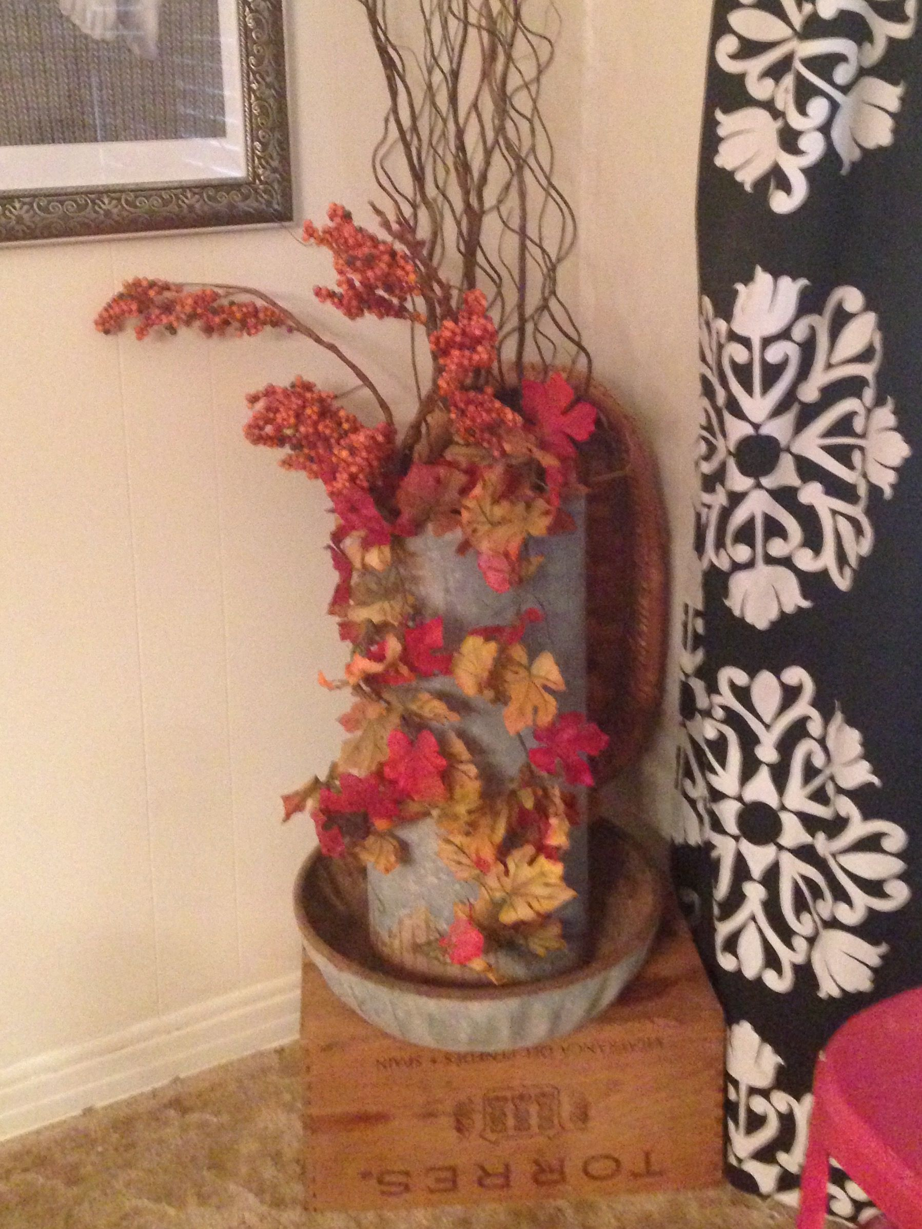 Old galvanized chicken feeder turned planter.  Fall decorating.