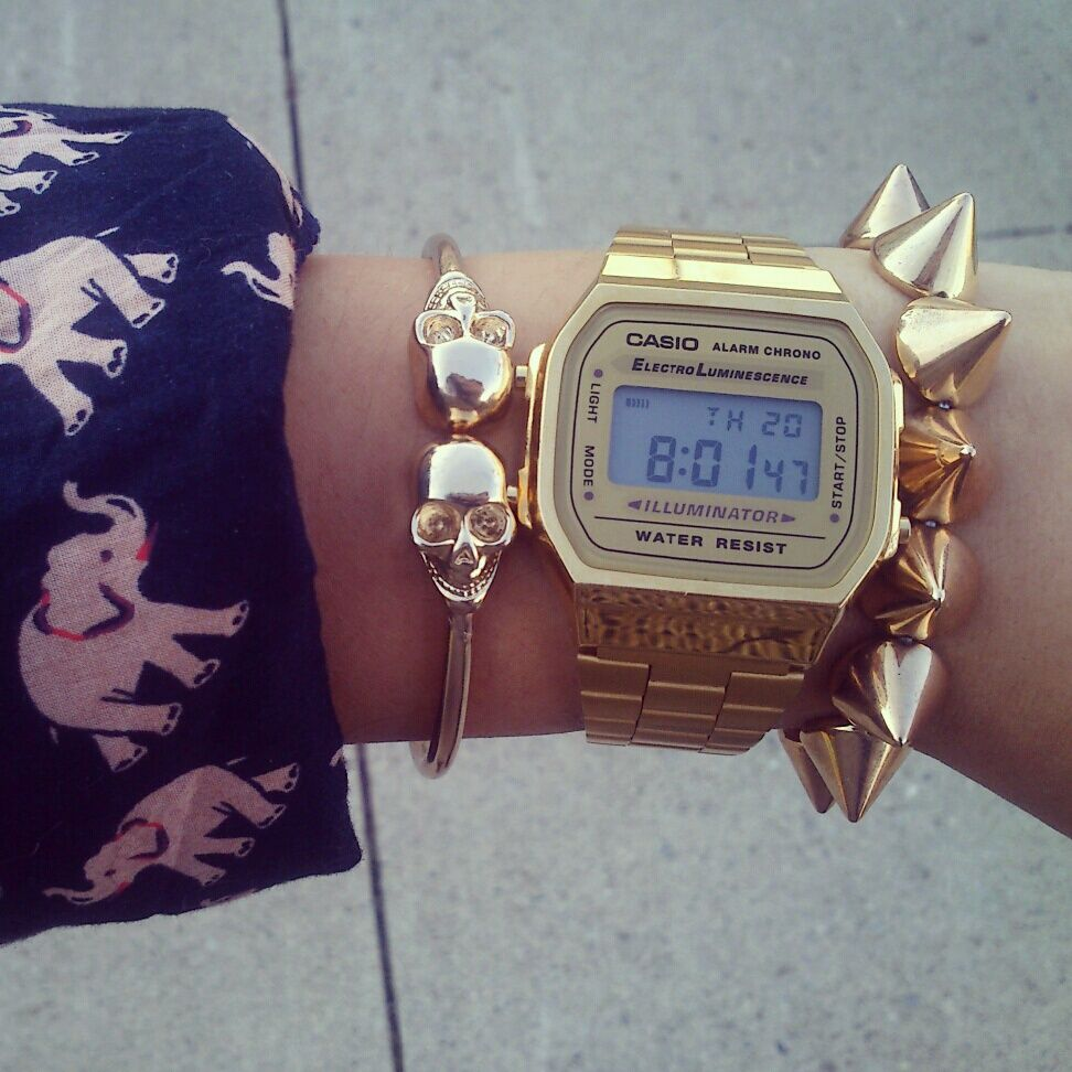 Gold Casio watch, gold skull bracelet http://neonwatch.tumblr.com/post/101744918811