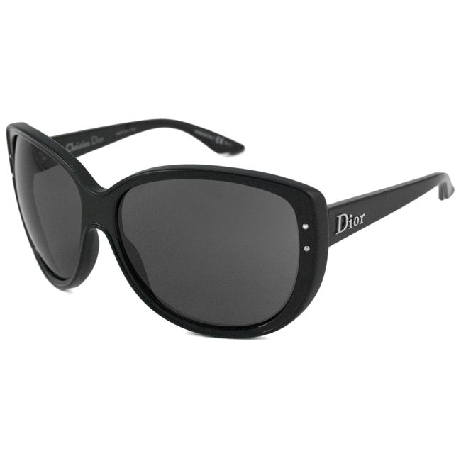 c39ab332dec0 These Christian Dior Sunglasses are an oversize cat-eye inspired  rectangular plastic frame with metal studs on the side of the frame. The Dior  logo is ...