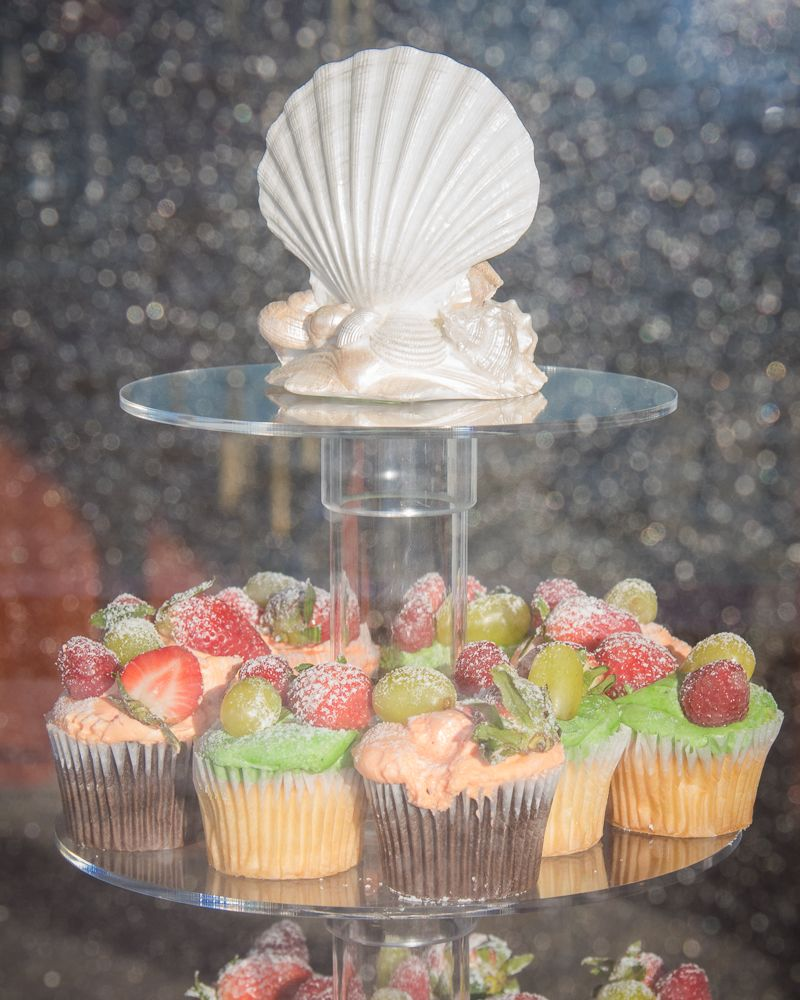 Yacht wedding decoration ideas  strawberry covered cupcakes Shades of green and pink and records of