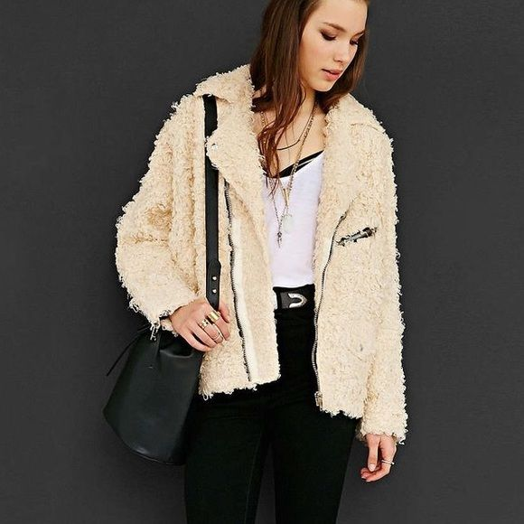 Fluffy Moto jacket So nice. It's a fluffy poodle like material but it is in a style of a Moto jacket! I think it's so different & cool. Unif x Urban Outfitters collab! NO TRADES. USE OFFER BUTTON ! SIZE LARGE. It's a cream color. Paid 200$ for this jacket & I haven't even worn it.  Urban Outfitters Jackets & Coats Utility Jackets
