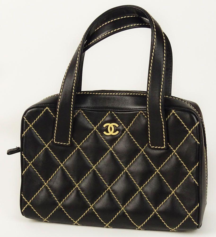 4f13c28015c7 A Chanel Surpique Wild Stitch Tote Bag. Goldtone CC Logo On Front ...