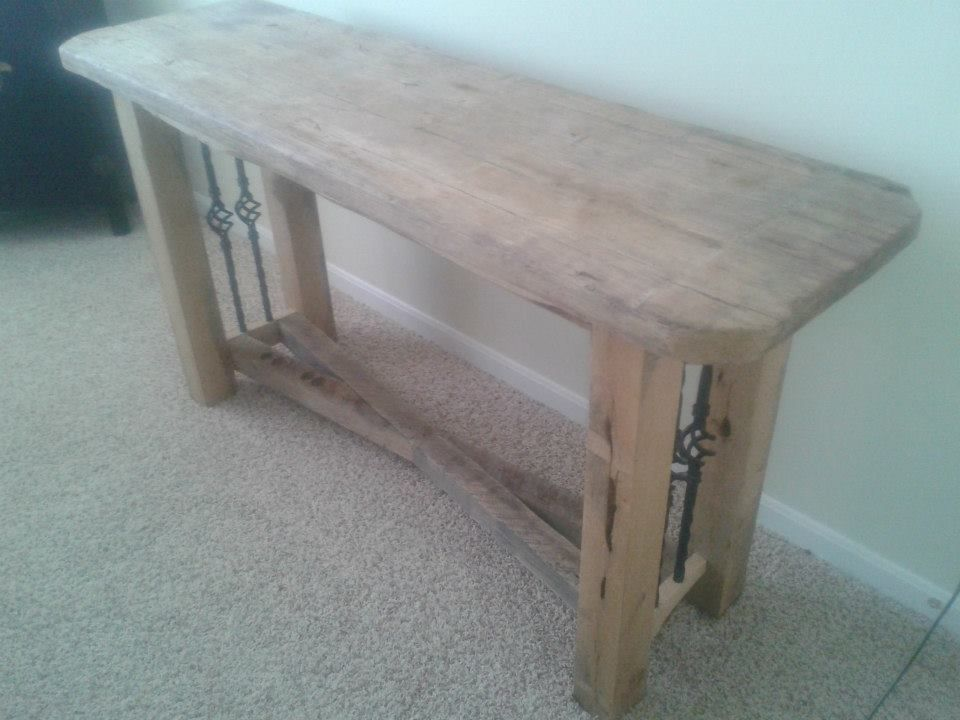 wooden sofa table or decorative table with rod iron spindles #rustic #wood #markelwoodwoodwork