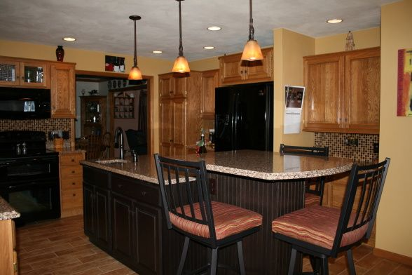 Hmmm.....we have oak cabinets with black accents. I'm ...