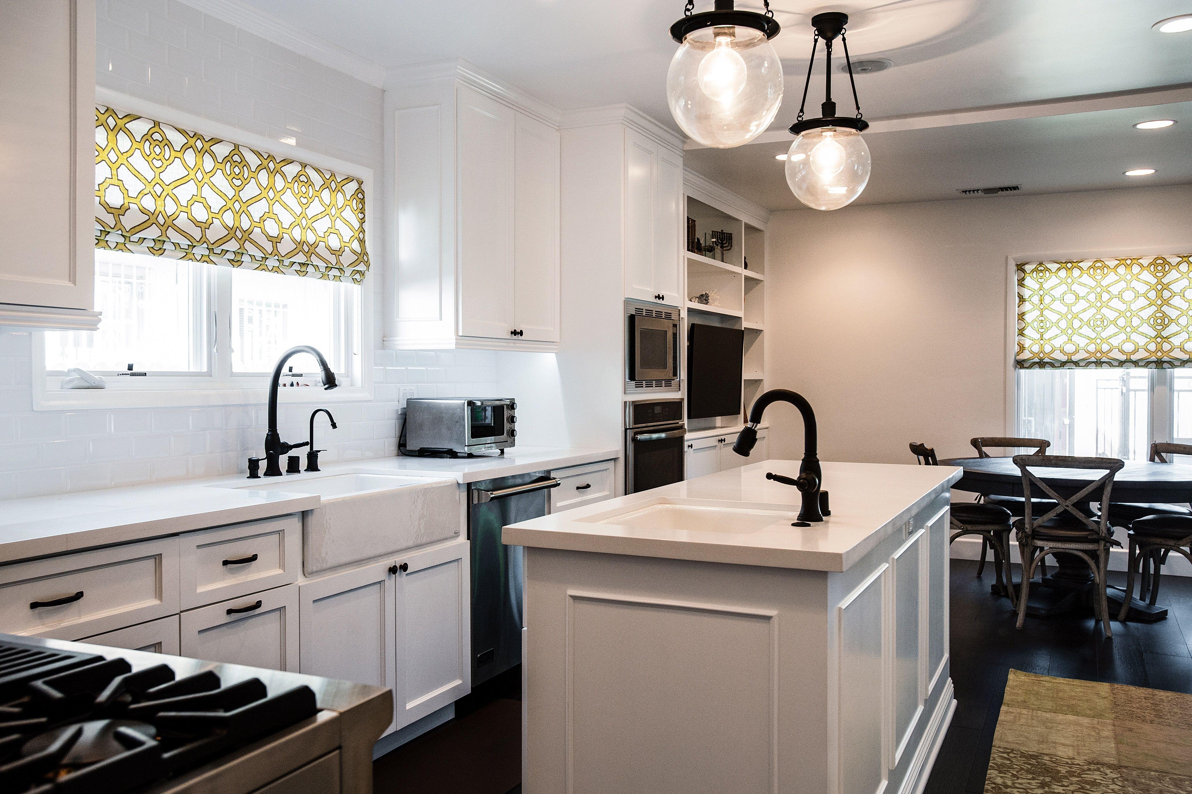 White kitchen, oil rubbed bronze hardware, Caesar stone countertops, white subway tile