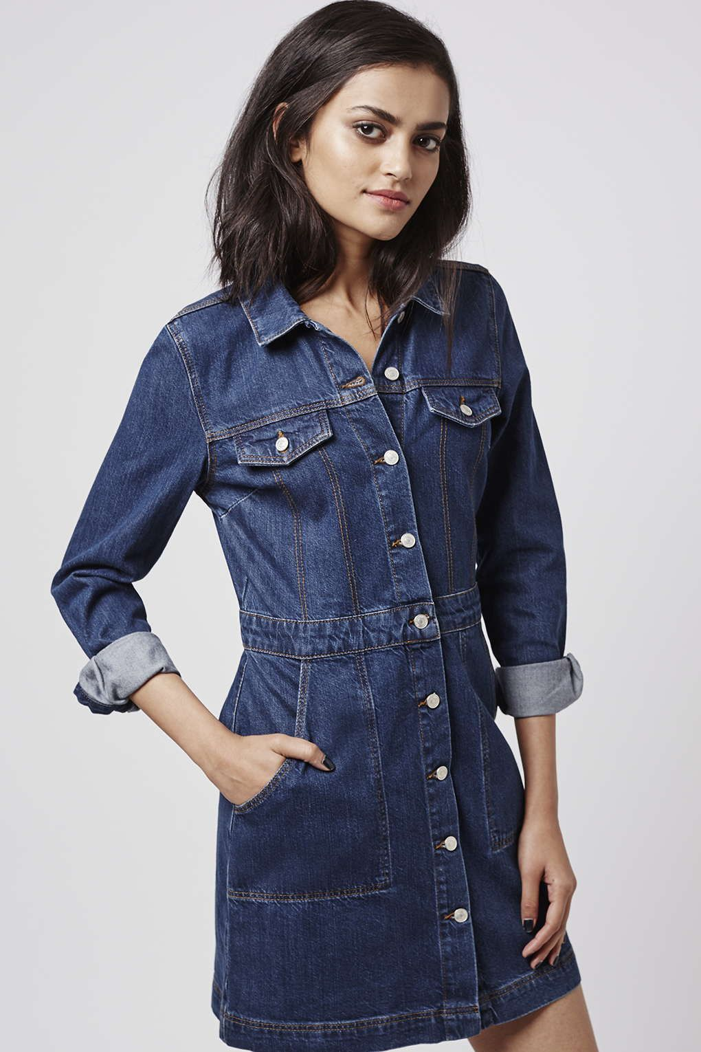 34a4480088d Channel western vibes in this button down denim dress in an Indigo wash.   Topshop