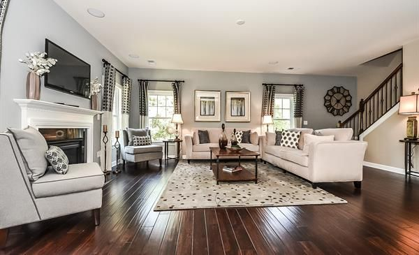 The Westley has a wide open floor plan with hardwoods, windows and a gas  fireplace in the family room. It's pictured here with a gray color scheme.