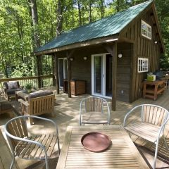 This house may be tiny on the inside, but it comes with an extra large wraparound deck to maximize outdoor living space in the summer months. . Browse more photos from the River Cabin gallery, only on FYI.tv.