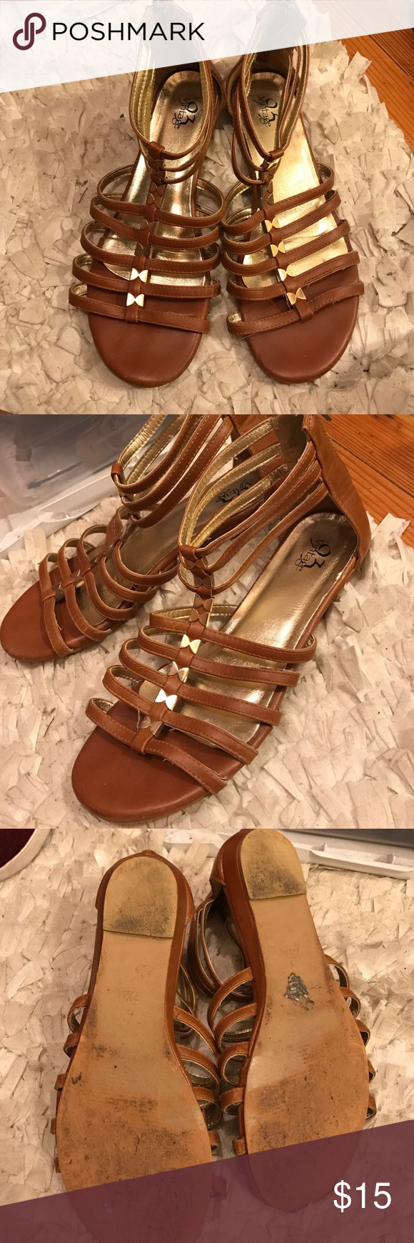 Brown bowed gladiators Size 7.5 gladiators. Got them from Francesca's collection! Don't wear anymore but really cute for the summer. It has gold bows on the front! Francesca's Collections Shoes Sandals