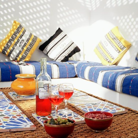 outdoor floor seating. Lounge-y Outdoor Dining. Looks Moroccan With The Overhead Lattice And Tiles. Love Blue White Stripes On Floor Cushions Contrasting Seating