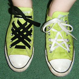 Entire website is devoted to shoelaces!  Someone had waayyyy to much time on their hands, but it's still freaking brilliant.  I'm totally redoing my Converse laces now!