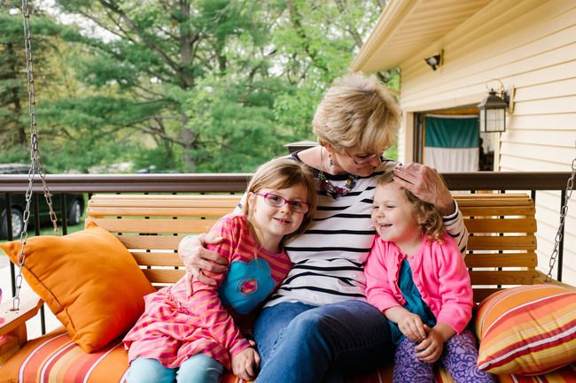 Adoring grandmother with her two granddaughters