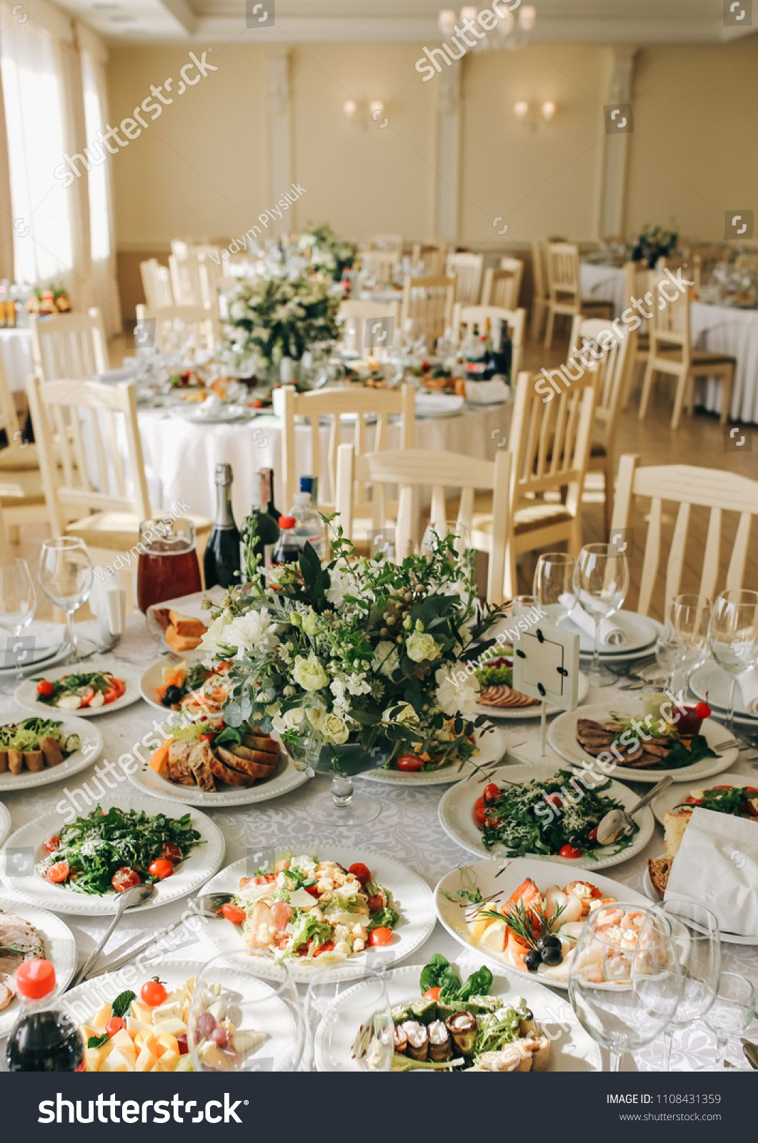 Beautifully Set Round Tables At The Restaurant Delicious Food Wedding Reception White Tablecloths And Flowers Table Cloth