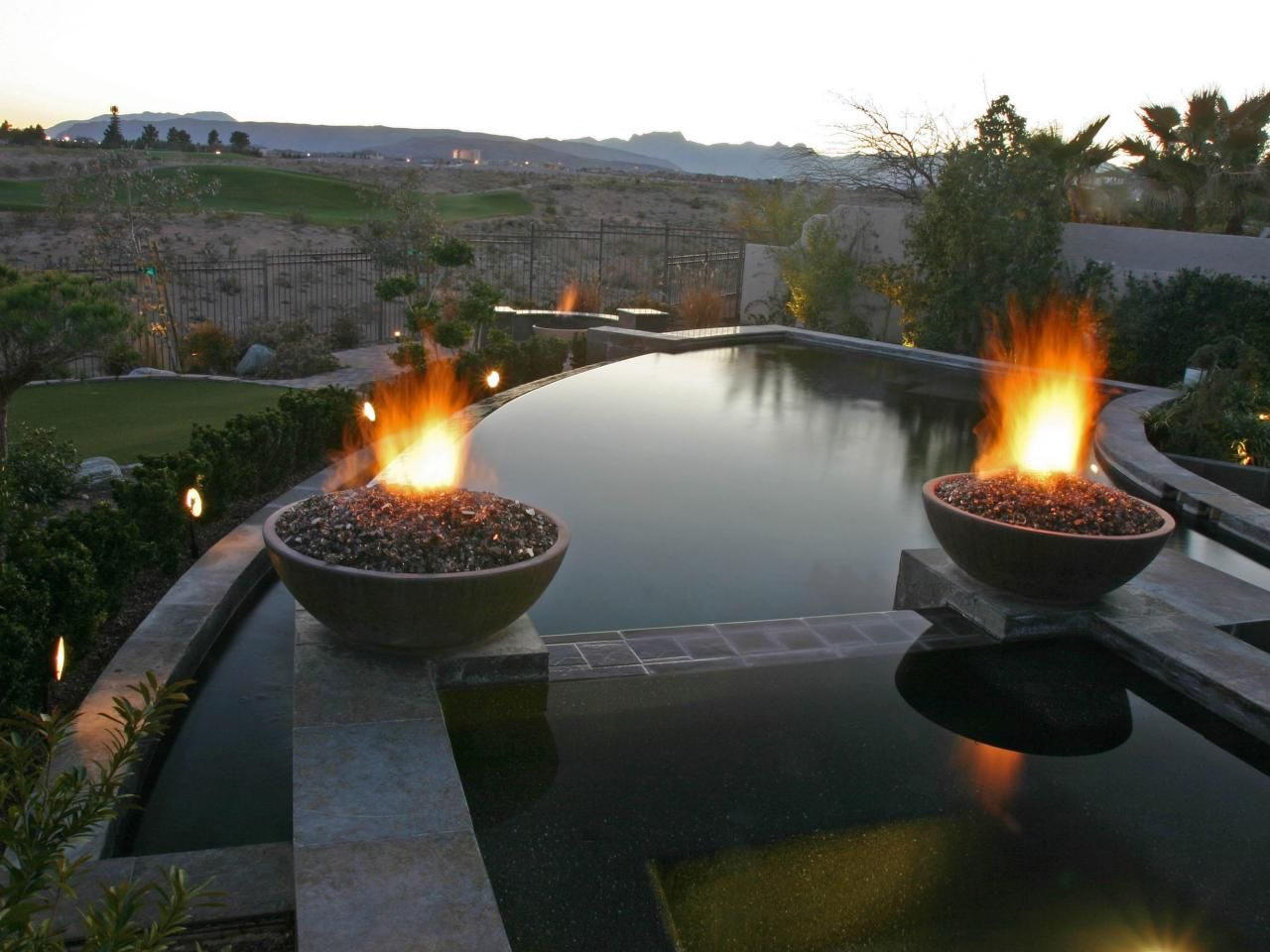 Crescent Shaped Pool With Fire Features