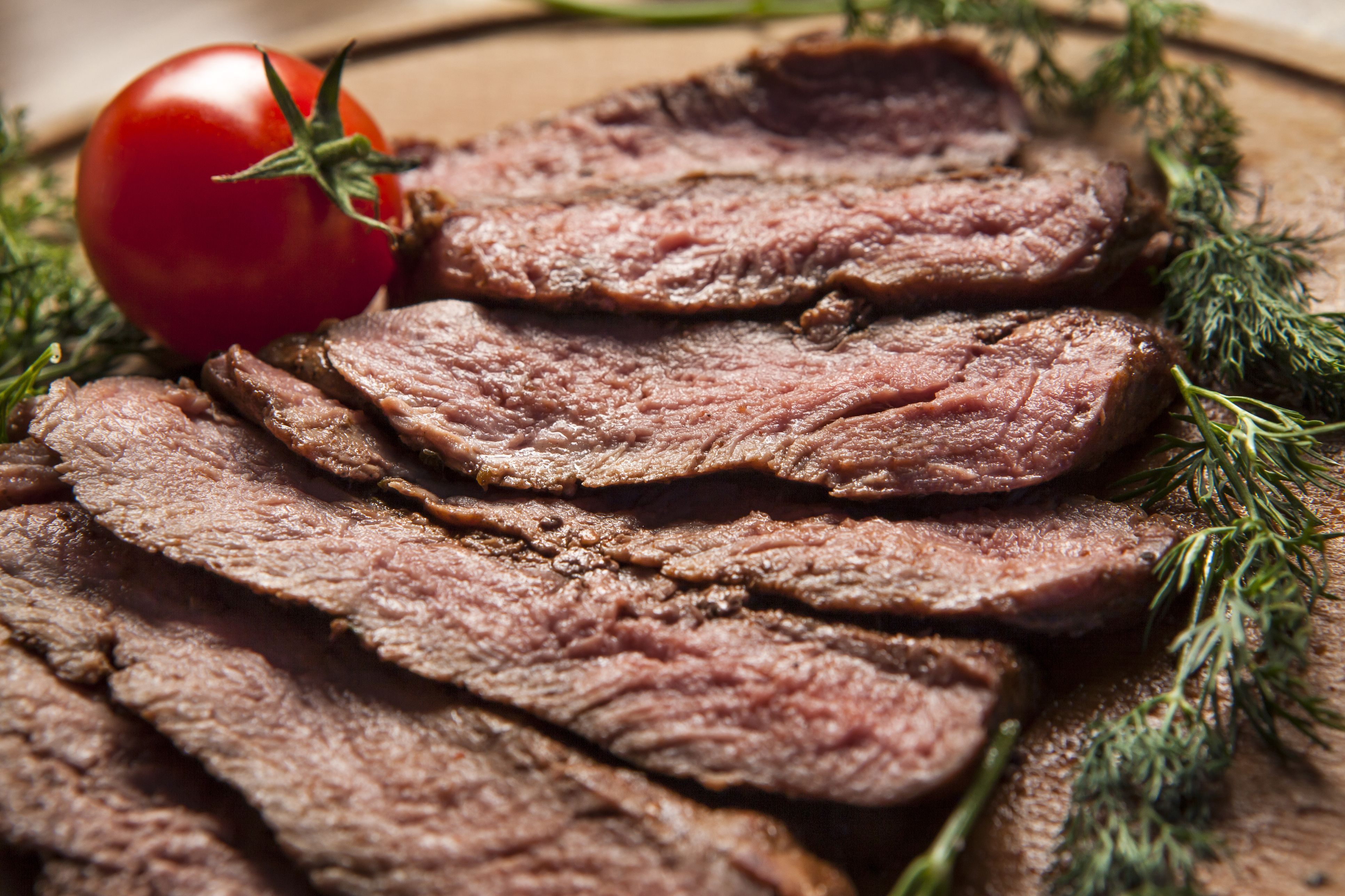 This thick broiled top round steak makes a delicious meal with baked potatoes and your favorite steamed vegetables.
