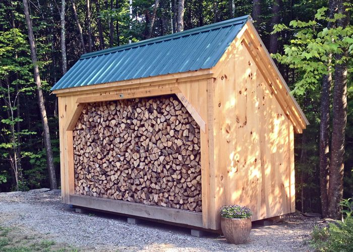 Designed to hold four cords of wood this wood shed is our for Traditional barn kits