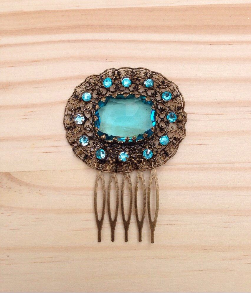 A personal favourite from my Etsy shop https://www.etsy.com/uk/listing/287872127/vintage-hair-comb-aquamarine-blue-bronze