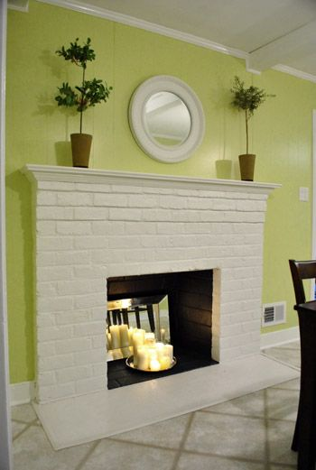 Maybe paint the inside of my white fireplace black? It would help ...