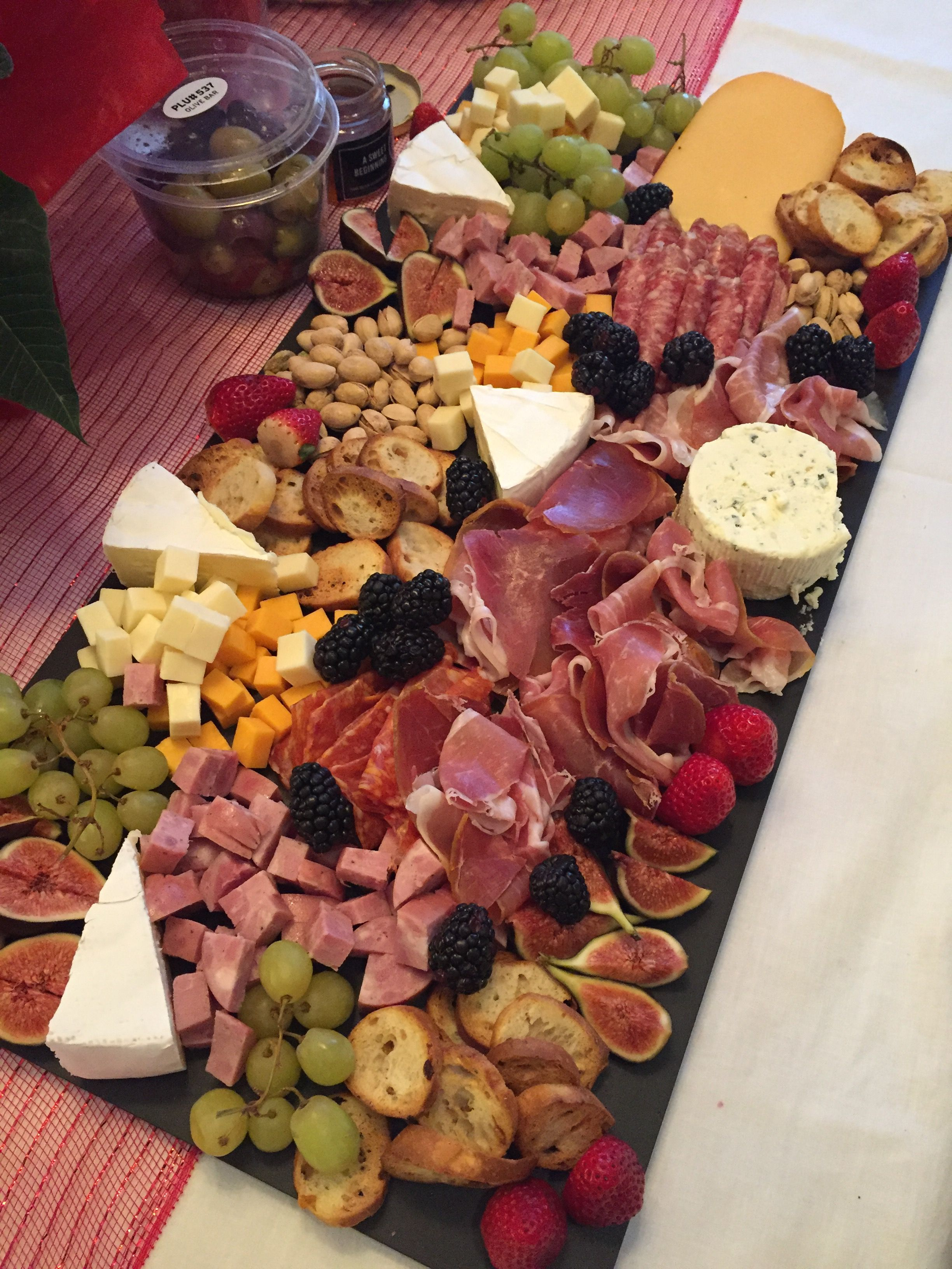 A Deluxe Charcuterie Platter With A Variety Of Meats Cheeses And Fruit Perfect For Any Occasion From Potlu Party Snack Food Wedding Buffet Food Food Platters