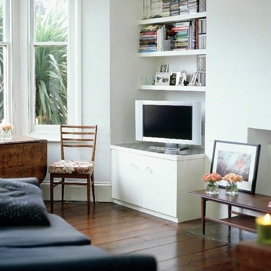 Living room with wood floor, sofa and white TV unit | Home ...