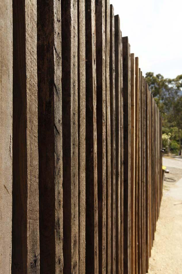 Vertical Timber Wall As Sinuous Ribbon But Randomly