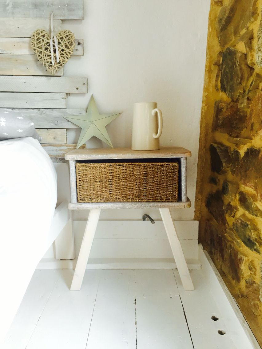 Whitewashed nightstand. Lime washed rustic bedside table with basket.