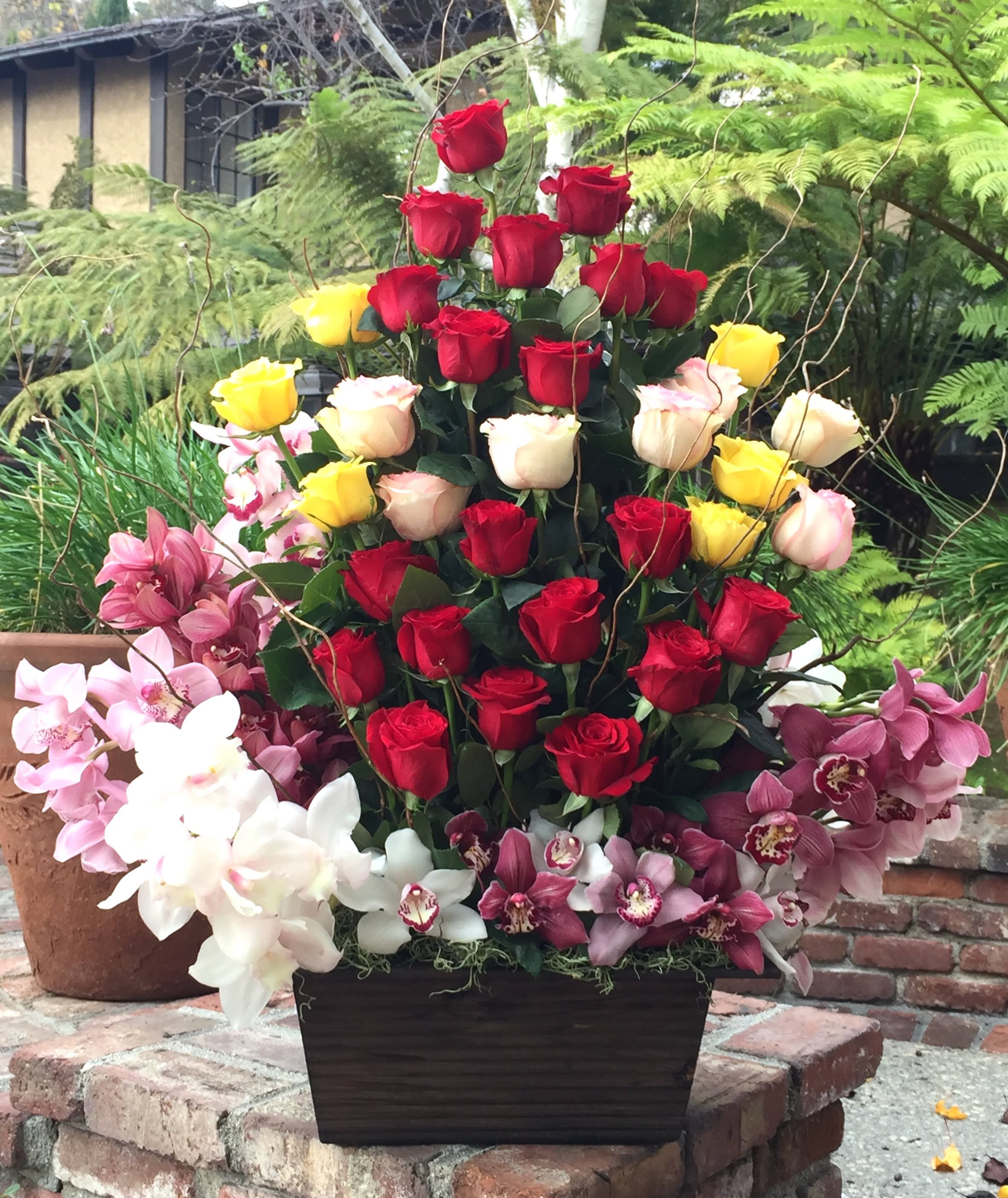 Grandeur roses and orchids bouquet by westwood flower shop