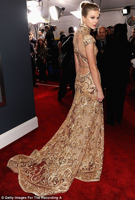 And the award for most eye-catching gown goes too... Fergie, Katy ...