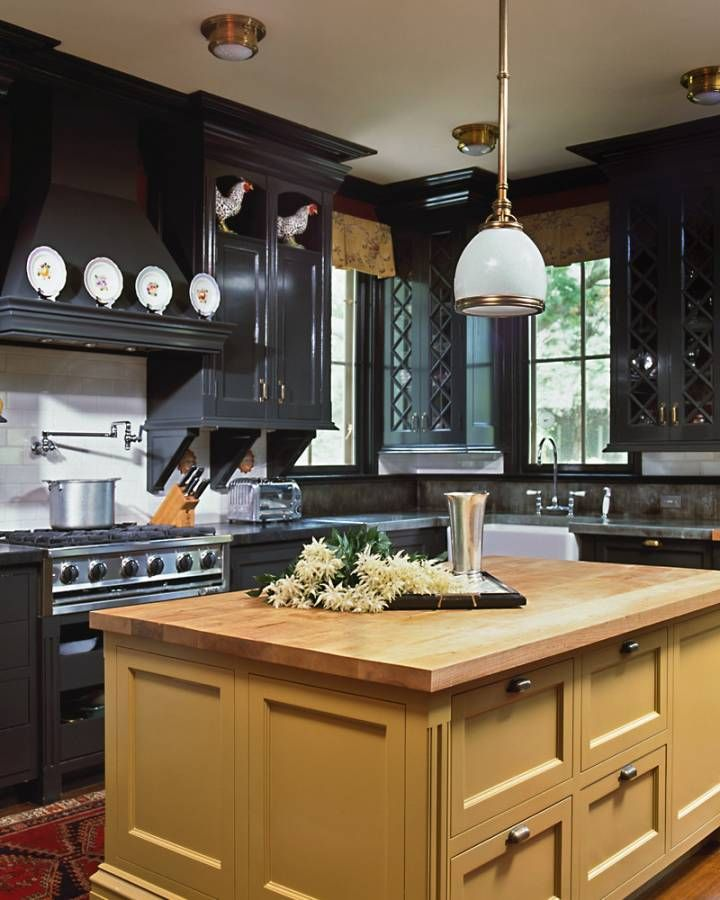 Black cabinets with a mustard island - Austin Patterson ...