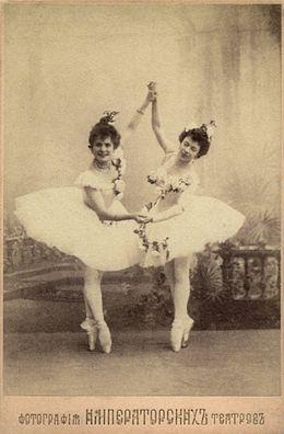 Pierina Legnani (left) — the first ballerina ever to be titled as Prima ballerina assoluta — with the Prima ballerina Olga Preobrajenskaya (right). They are costumed for the roles of Medora and Gulnare in the scene Le jardin animé from Marius Petipa's final revival of Le Corsaire for the Imperial Ballet. St. Petersburg, 1899.