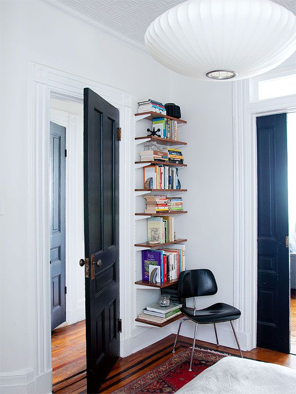 from manhattan nest i like the way the wood tone of the shelves makes the