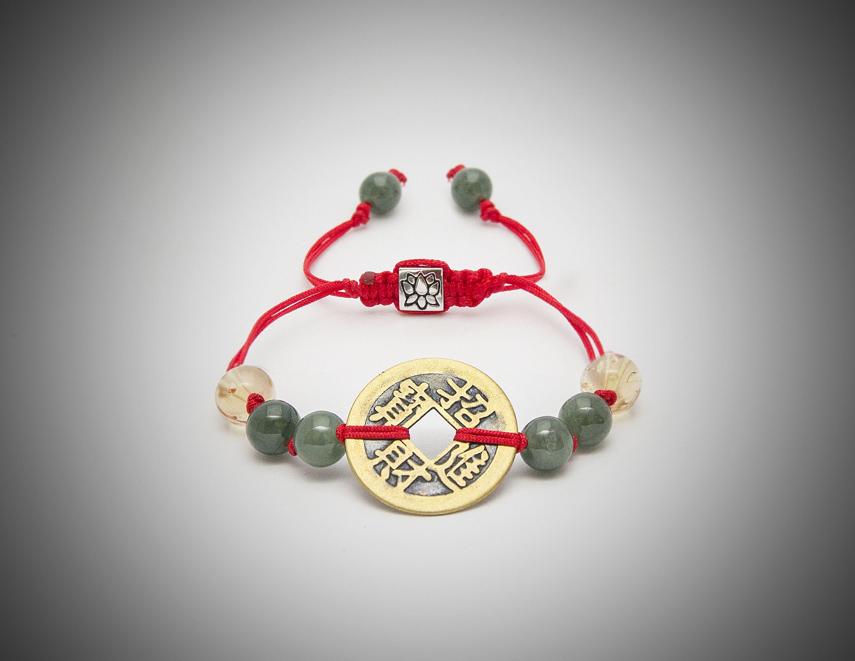 7219ec74a1c2 Lucky coin.La moneda china atadas con hilo rojo y energizadas con ...