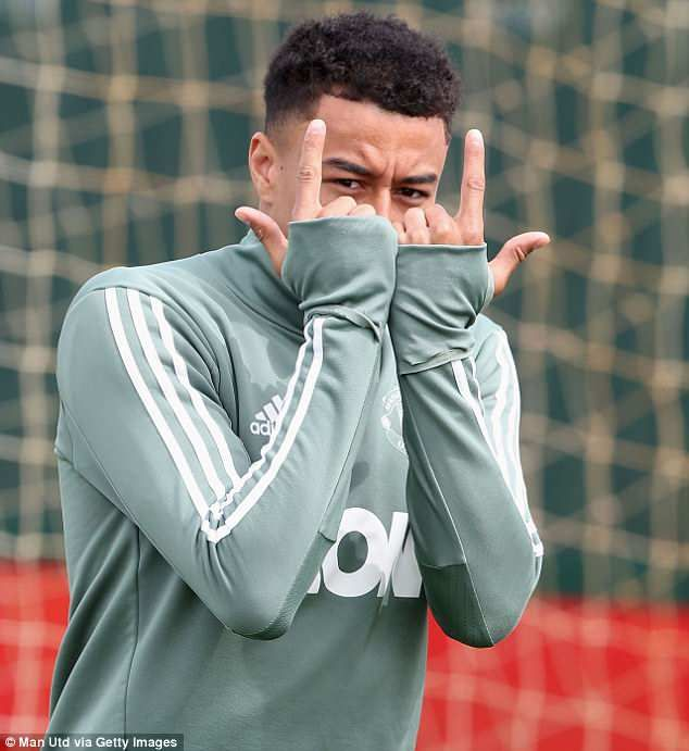 Jesse Lingard poses for the camera with his trademark 'J-Lings' finger gesture in training