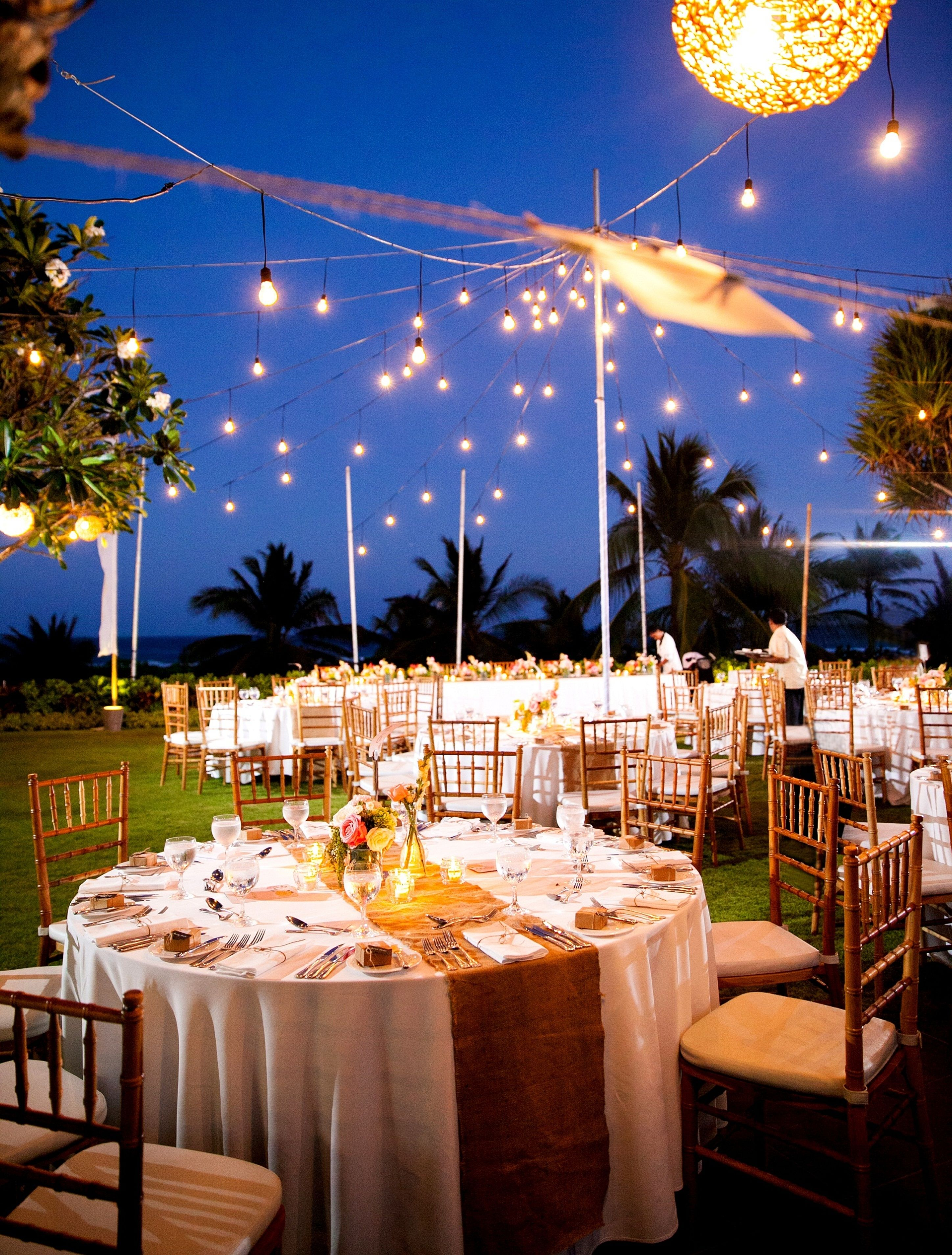 Gold hues and twinkle lights set the scene for a romantic and gold hues and twinkle lights set the scene for a romantic and memorable tropical outdoor wedding junglespirit Gallery