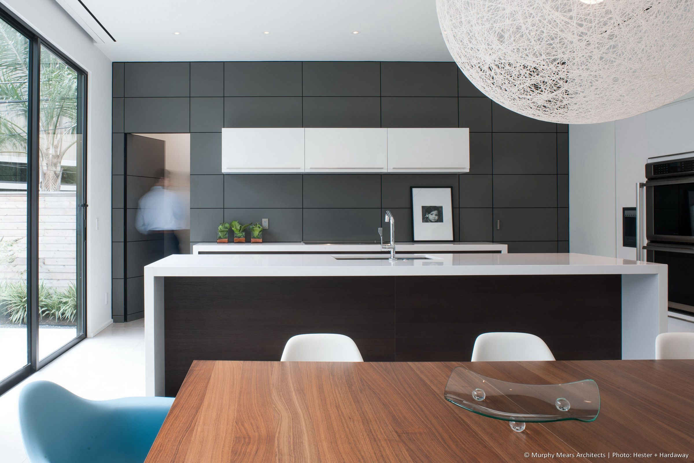 Hidden door within the kitchen wall panels provides access to pantry ...