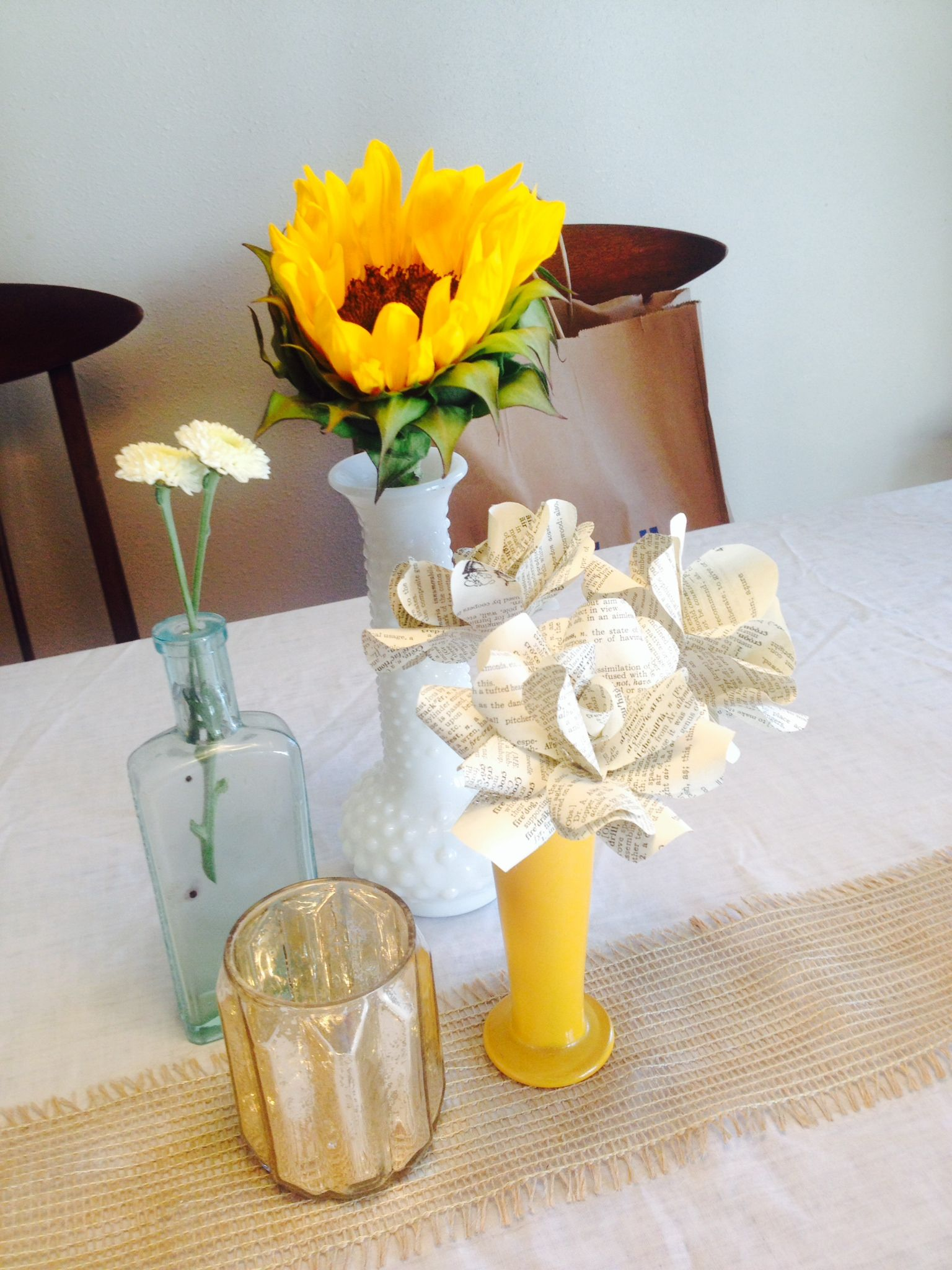 Sample centerpieces antique bottles burlap paper
