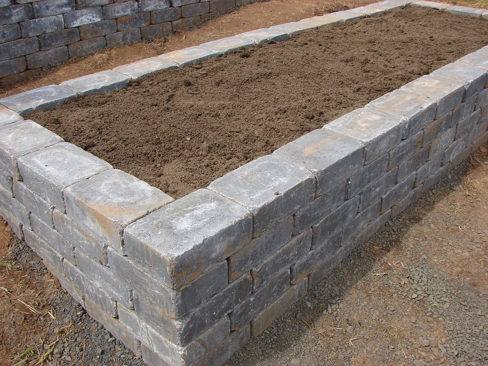 Raised Bed Made Out Of Stone Garden Pavers Garden Beds