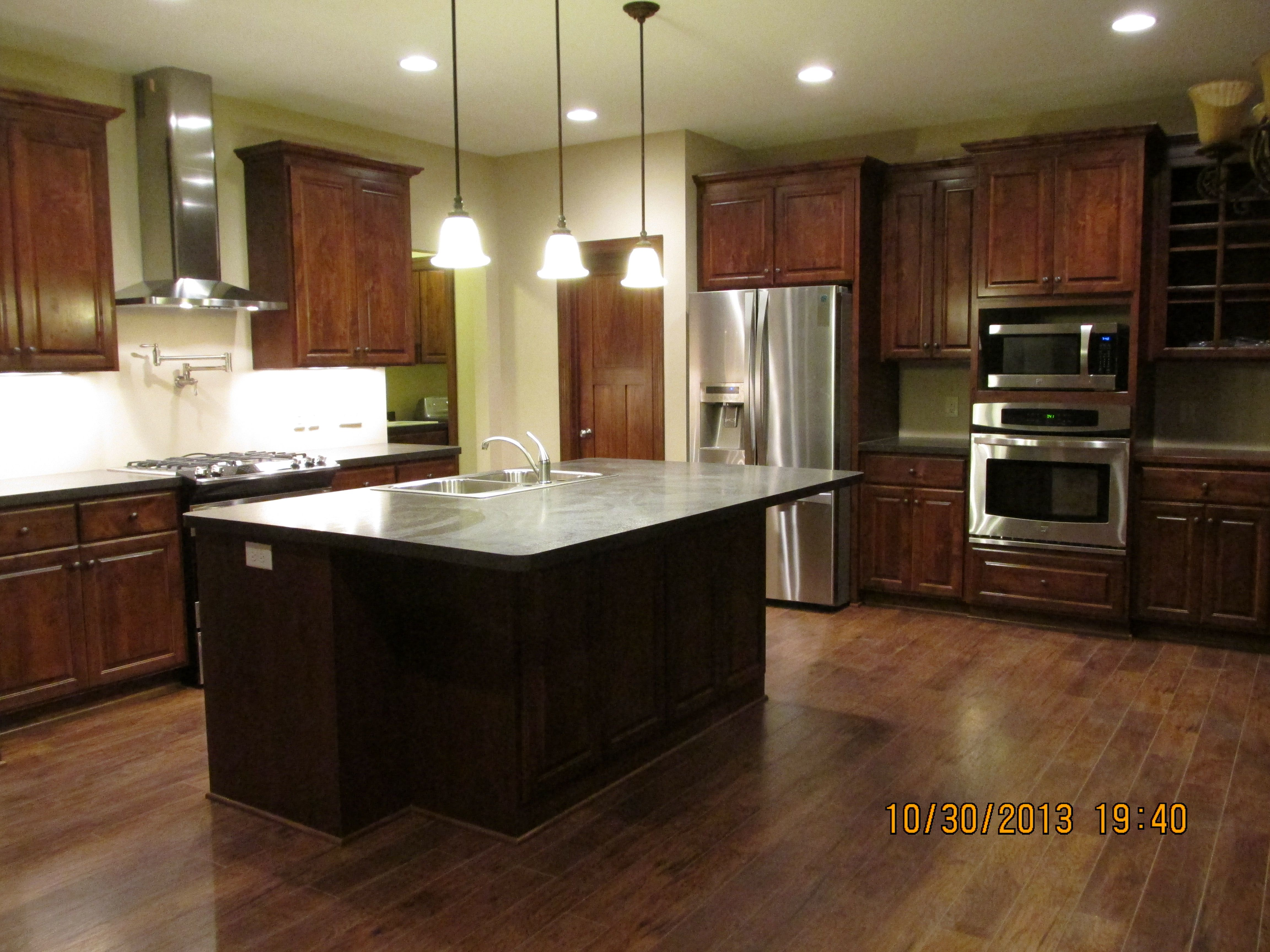 knotty alder cabinets w espresso stain popular color combination this year knotty alder on kitchen cabinets color combination id=12451