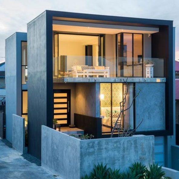 Modern contemporary home filled with cement for stability for Modern townhouse exterior
