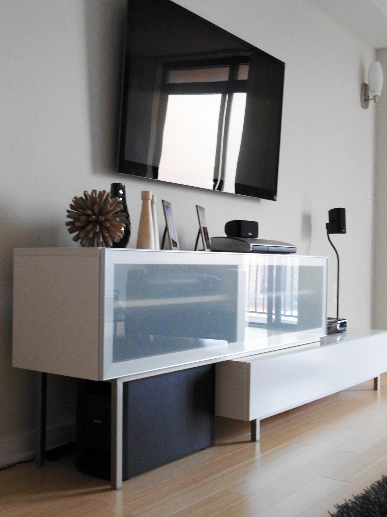 Attractive Media Storage Console #28 - A Wall-mounted Flat-panel TV Hangs Above A Modern Media Storage Console In  This Bachelor Pad Living Room. The Storage Unit Provides The Perfect  Solution For ...