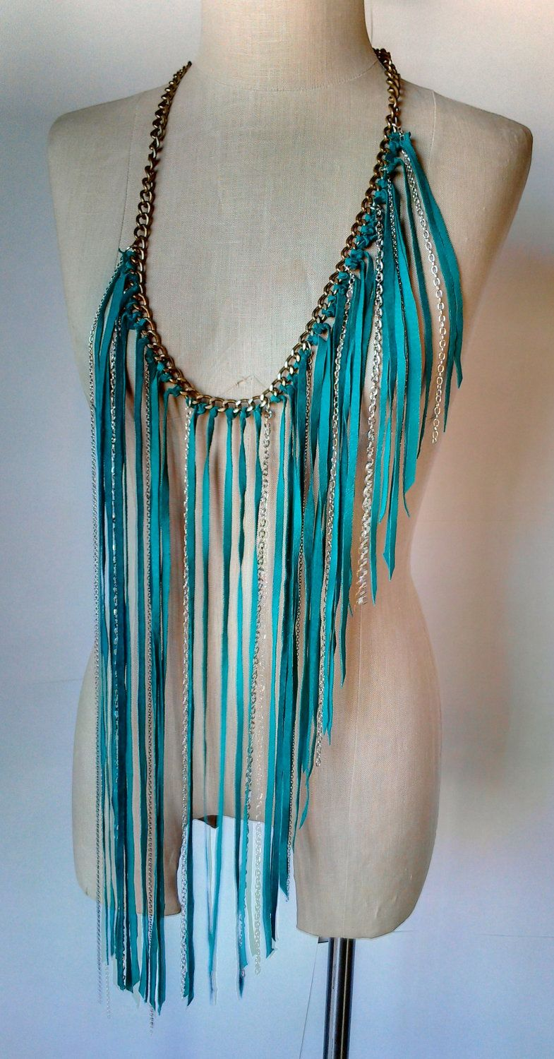 An easy to make fringe top. Start with a chain link belt or necklace. Add t-shirt fringe or leather strips. You can also add beads.