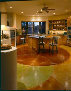 This One Of A Kind Kitchen Floor Includes Perfectly Placed Geometric Shapes Featuring An Array Of Brown Concrete Stained Floors Concrete Decor Concrete Floors